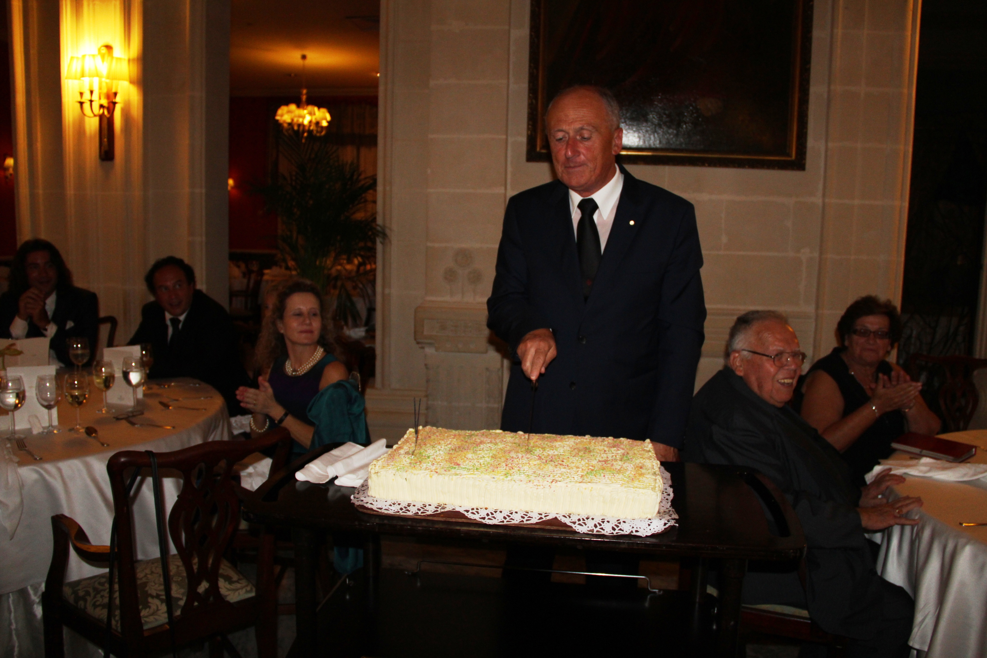 H.E. the Lieutenant cutting the anniversary cake.