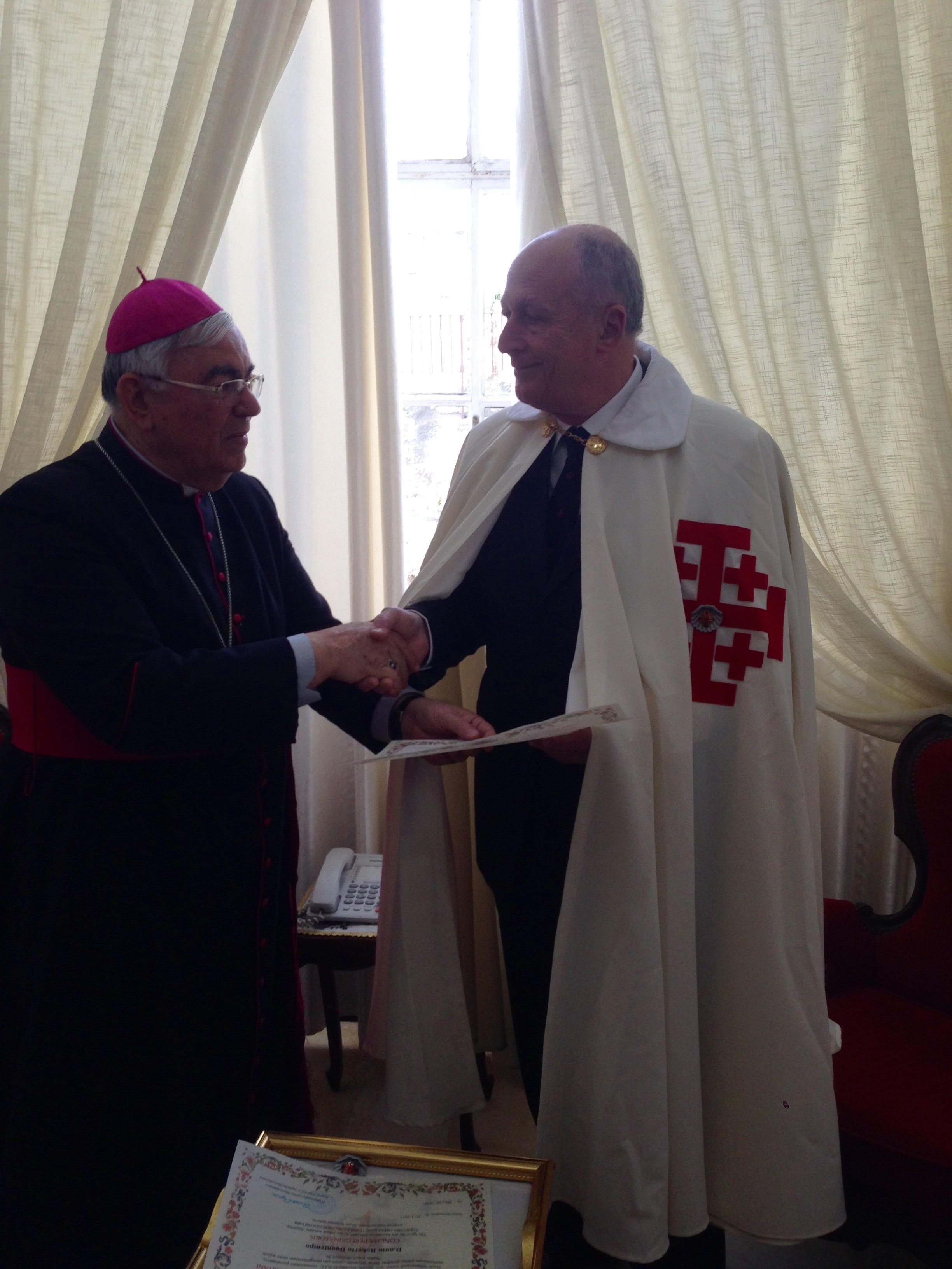 The Bishop Vicar of Nazareth, Mgr. Giacinto Boulos Marcuzzo, presenting the Pilgrim certificate to H.E. Eric Fenech Pace, Lieutenant for Malta