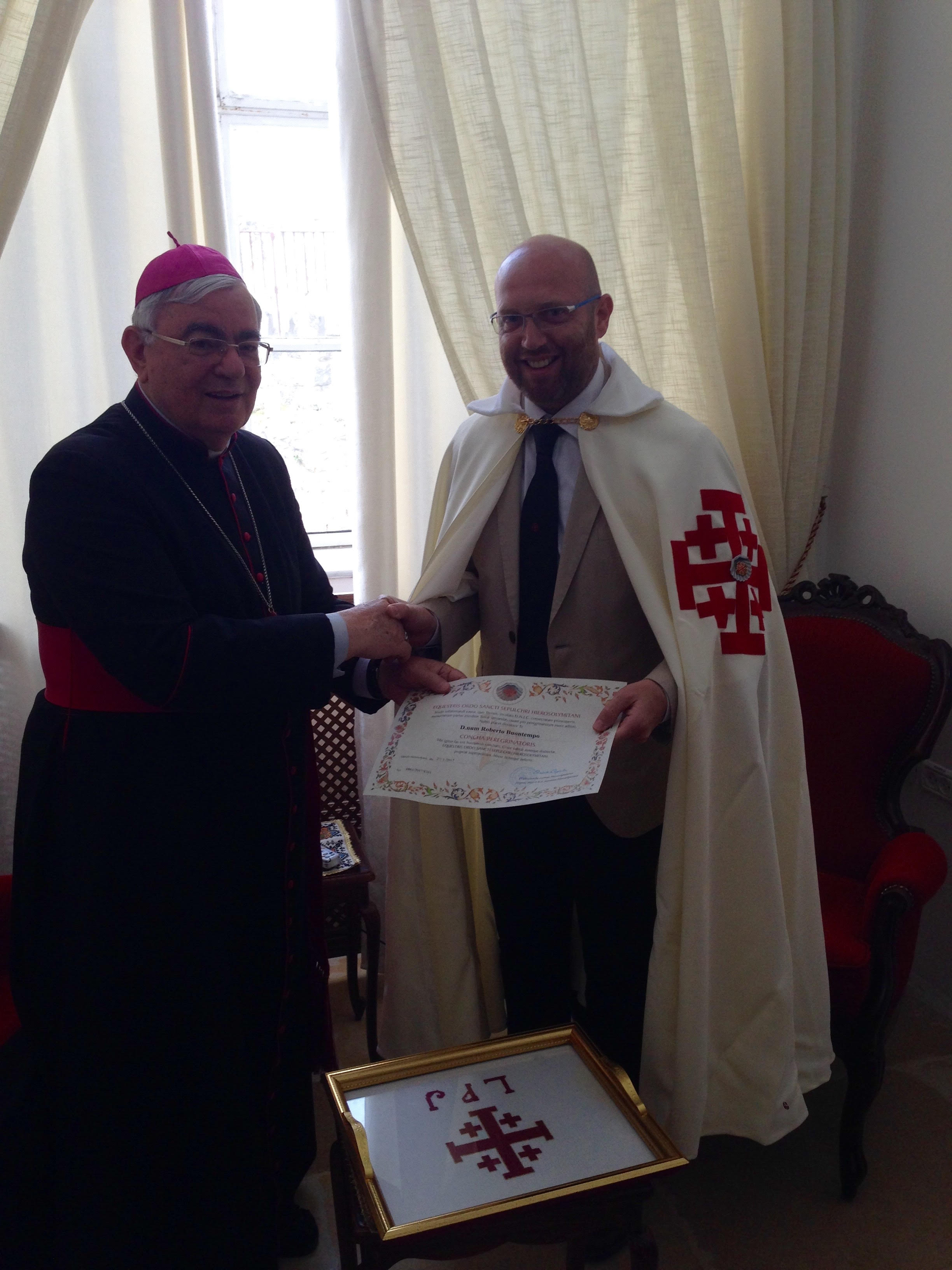 Bishop Marcuzzo presenting the Pilgrim certificate to Roberto Buontempo, Chancellor - Lieutenancy of Malta
